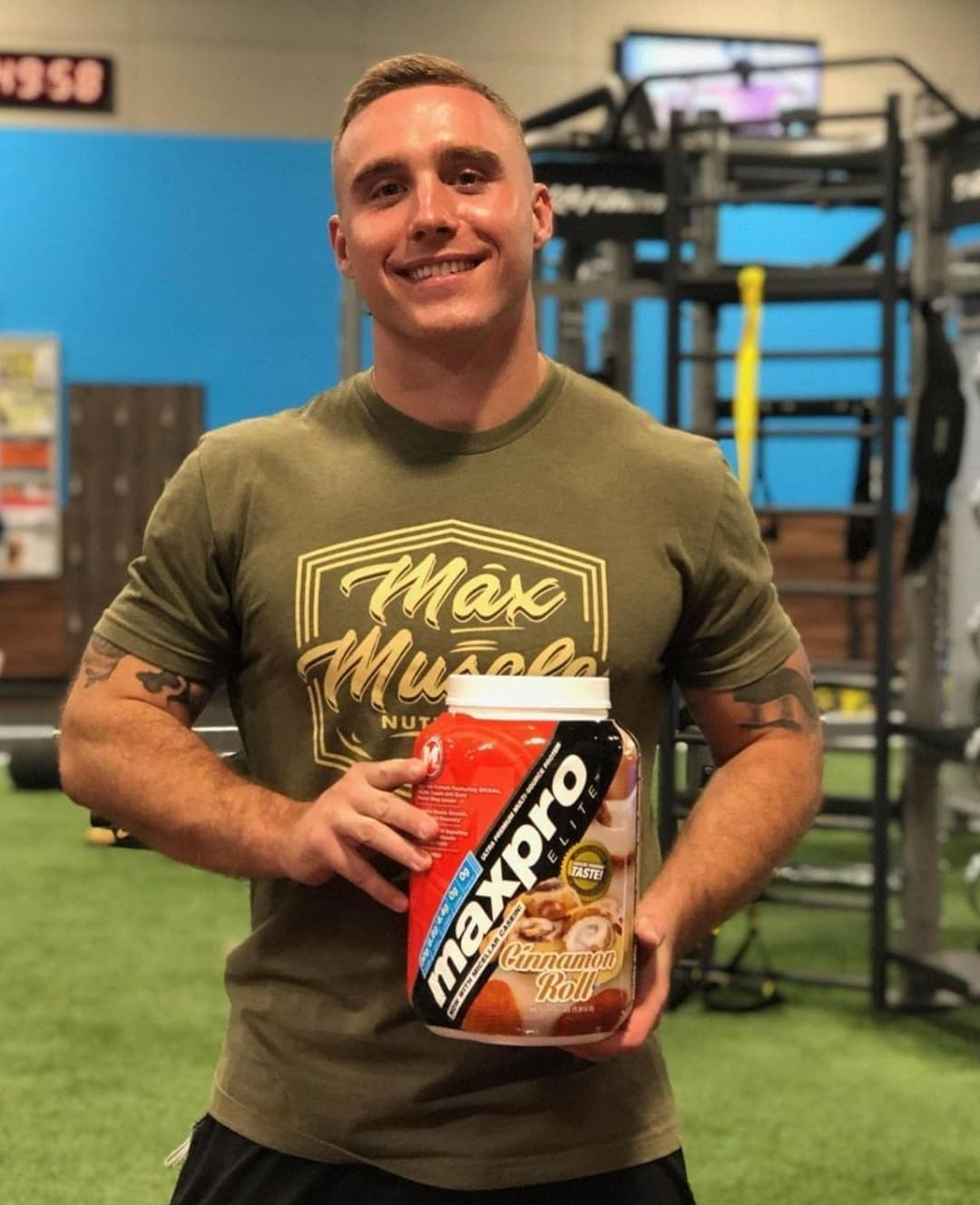 Child actor Lorenzo Brino posing for the camera inside a gym while holding a jar of MaxPro Elite protein   Photo: Instagram.com/mimi_brino