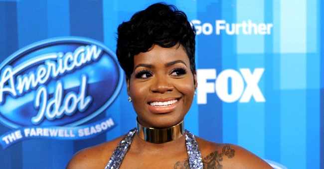 Fantasia Glows with Happiness Showing Off Post-pregnancy Figure in Floral Ensemble in Photos with Husband