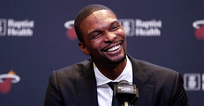 Chris Bosh Is All Smiles Wearing Pastel Outfits with His Beautiful Wife & Their 4 Kids (Photo)