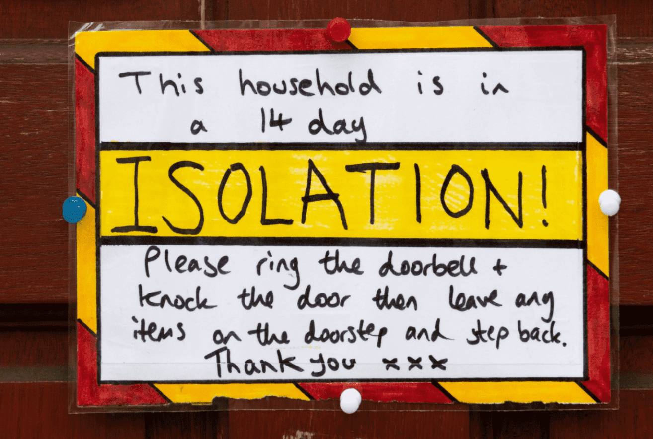 A sign on the door of a residential property where the household are in a 14 day isolation in accordance with new government guidelines on March 18, 2020 in Cardiff, United Kingdom. | Photo: Getty Images