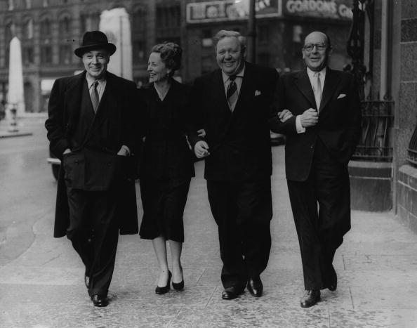 Charles Boyer, Agnes Moorhead, Charles Laughton, and Sir Cedric Hardwicke taking a stroll through Manchester, circa 1950s. | Photo: Getty Images