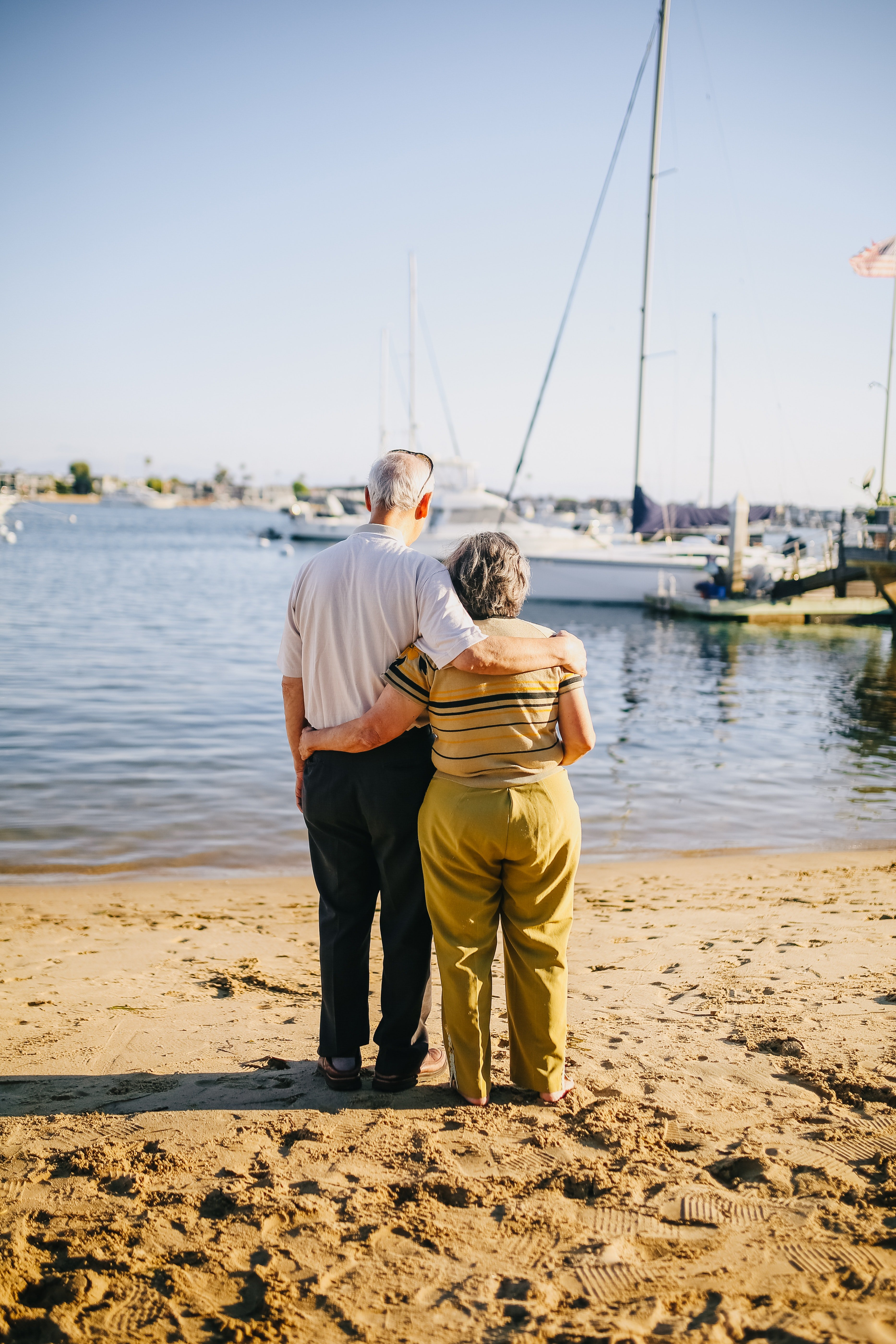 An elderly couple looking at the boats in the water. | Source: Pexels.