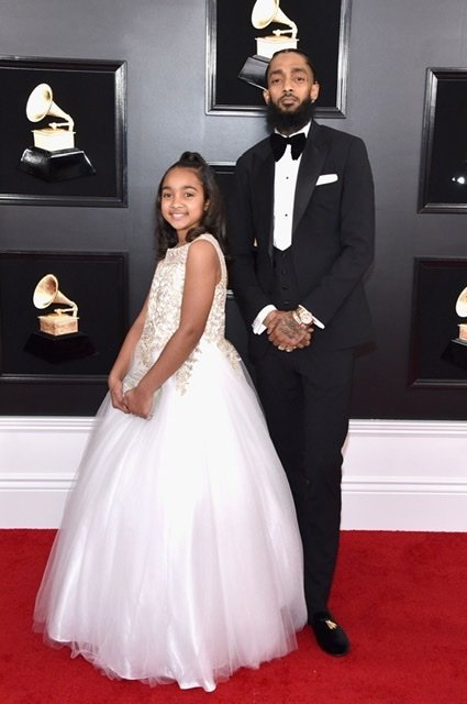 Nipsey Hussle and his daughter Emani at the 61st Grammy Awards in 2019 | Source: Getty Images/GlobalImagesUkraine