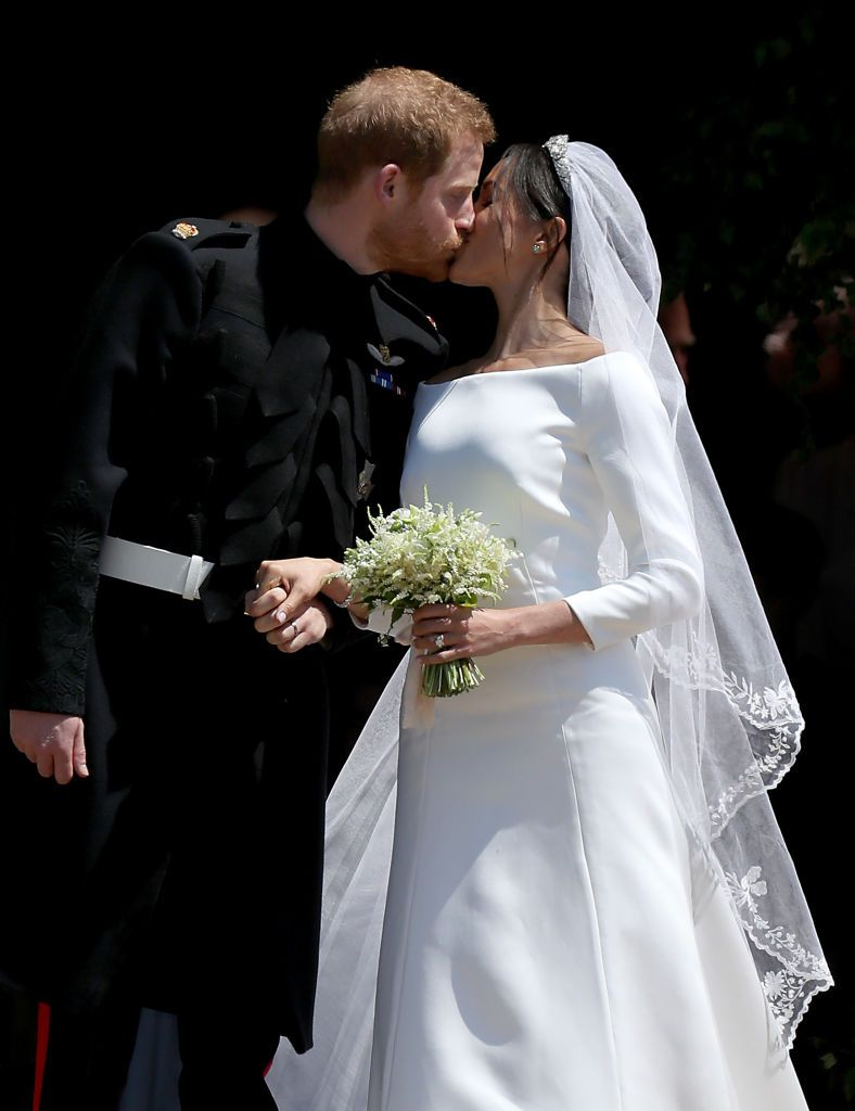 Prince Harry and Duchess Meghan share a kiss after their wedding at St George's Chapel on May 19, 2018, in Windsor, England | Photo: Jane Barlow - WPA Pool/Getty Images