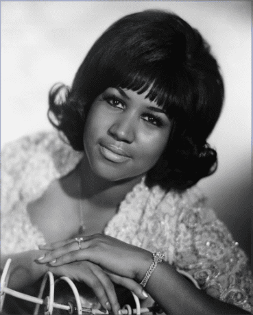 Seated portrait of R&B singer Aretha Franklin during her youth.   Photo: Getty Images