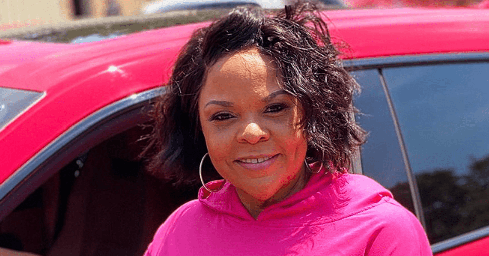 Tamela Mann's Daughter Tia Pours Her Curves into Tight Charcoal-Black Dress with White Stripes