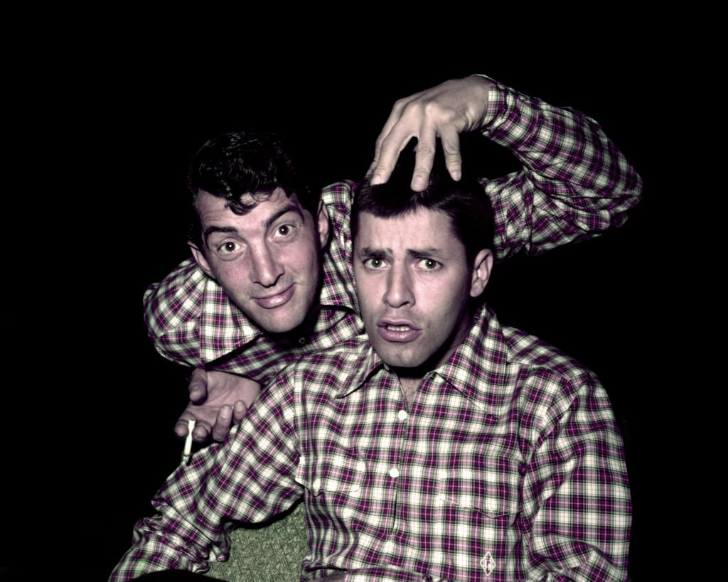 Portrait of American actors Dean Martin (born Dino Crocetti, 1917 - 1995) and Jerry Lewis (born Jerome Levitch, 1926 - 2017), both in plaid shirts, late 1950s or early 1960s.   Source: Getty Images