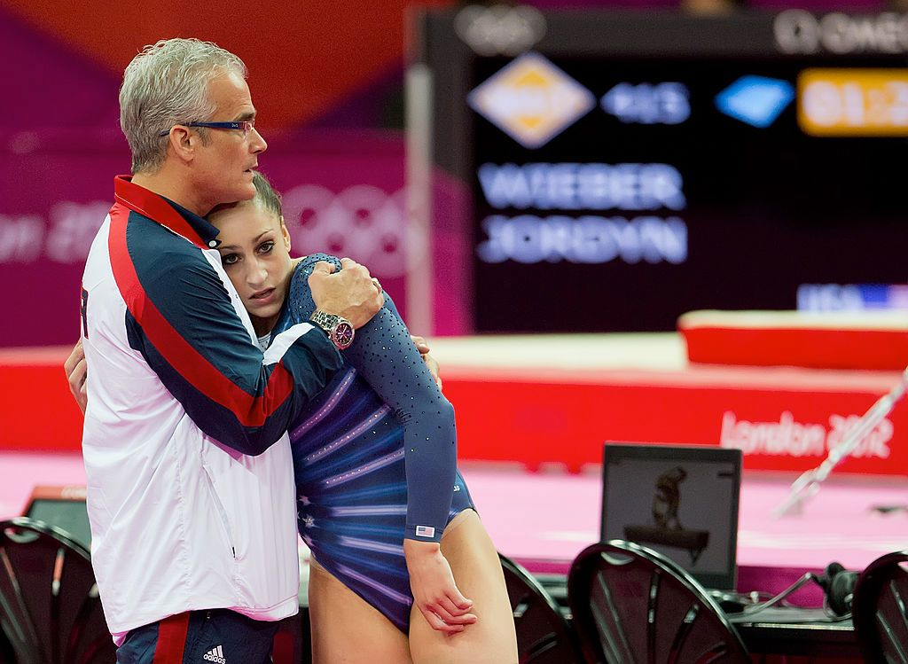 Athlete Jordyn Wieber being hugged by coach John Geddert during the women's floor exercises apparatus finals at North Greenwich Arena during the 2012 Summer Olympic Games in London, England | Photo: David Eulitt/Kansas City Star/Tribune News Service via Getty Images