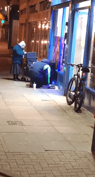 The homeless man taking a seat again to enjoy his warm soup. Image credit: Facebook/Charlie Franklin