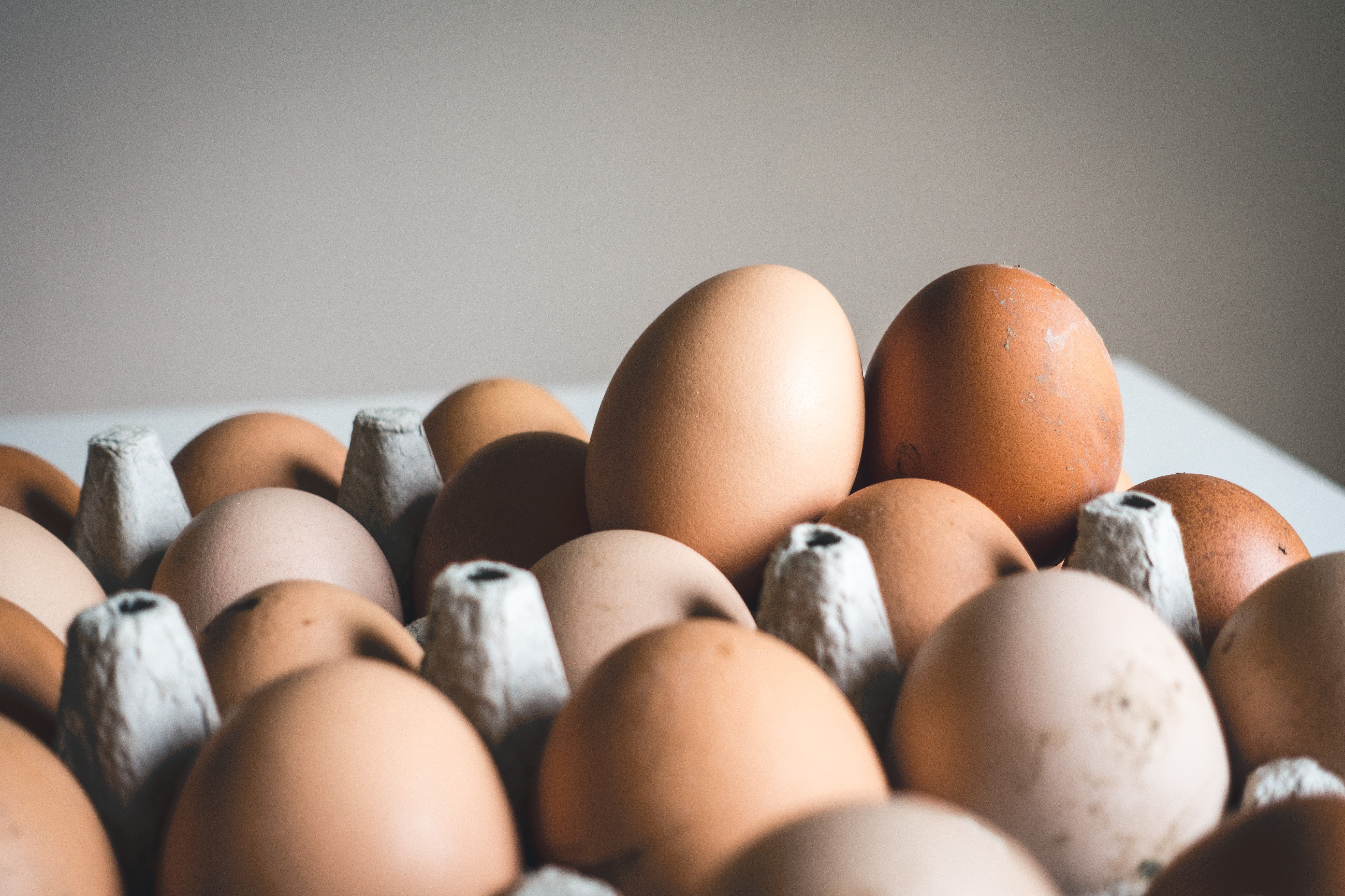 Two extra eggs in a crate | Source: Unsplash.com