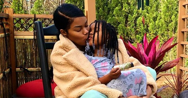 Teyana Taylor Kisses Elder Daughter Junie Next to a Buddha Statue and Says Energy Is Everything