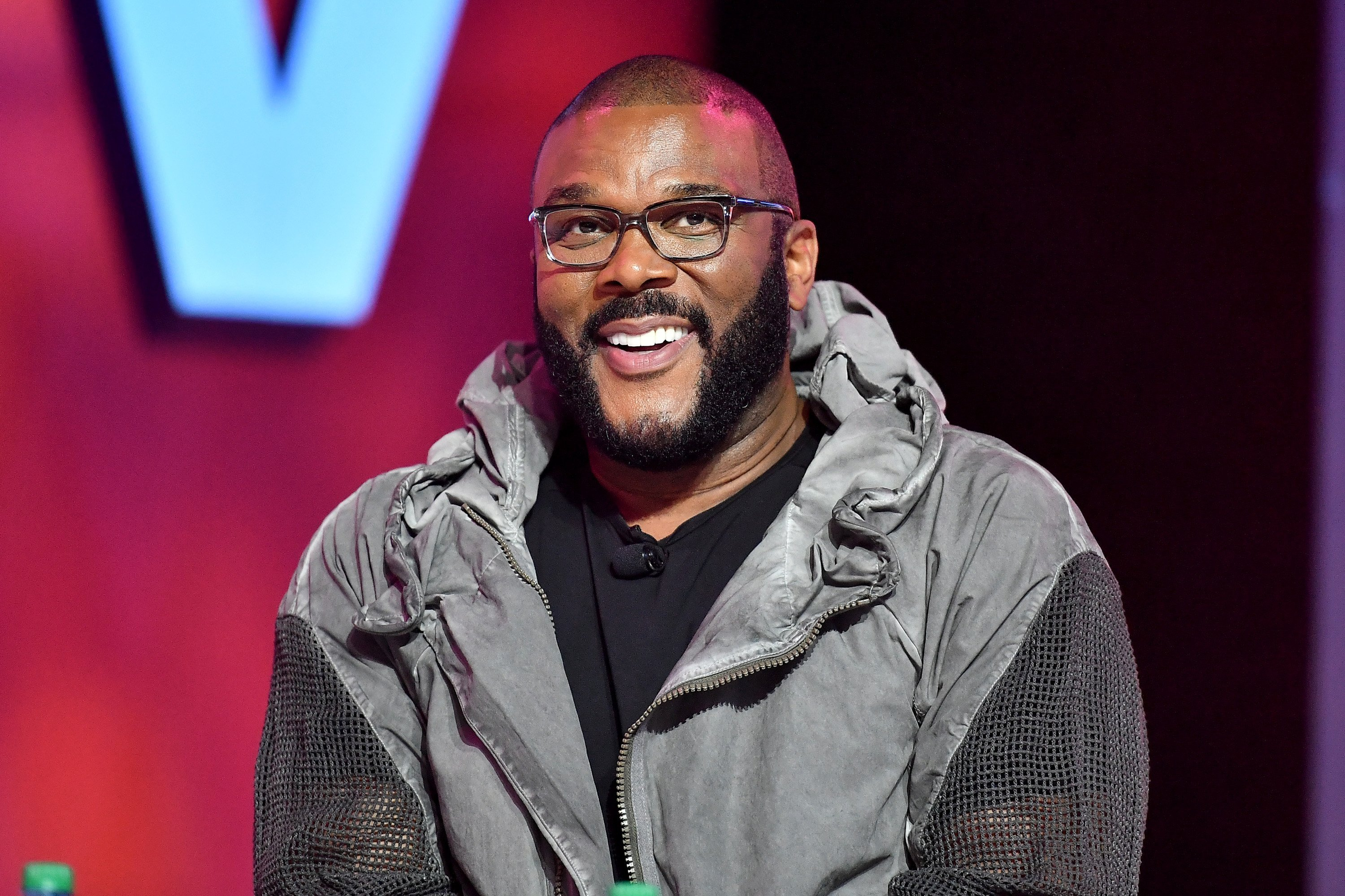 Tyler Perry speaks on stage at 2019 ESSENCE Festival on July 07, 2019| Photo: Getty Images