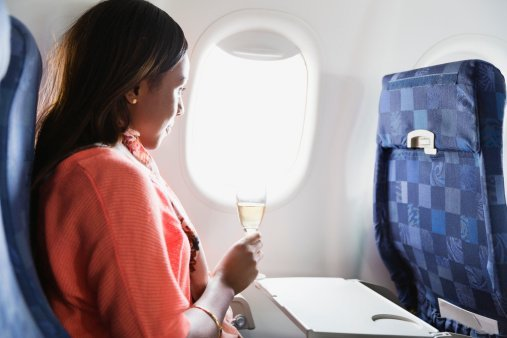 Woman on a flight   Photo: Getty Images