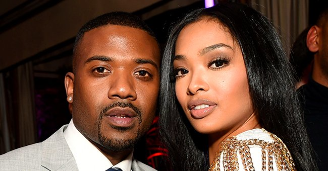 Ray J's Wife Princess Love Flaunts Baby Bump in Blue Dress with Deep Cleavage & a Slit at 9 Months in New Pic