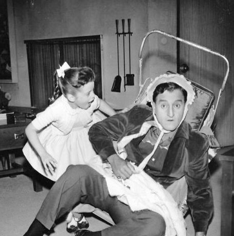 "Danny Thomas and his television daughter, Angela Cartwright, play house in this publicity photo from the television program ""Make Room for Daddy."" 