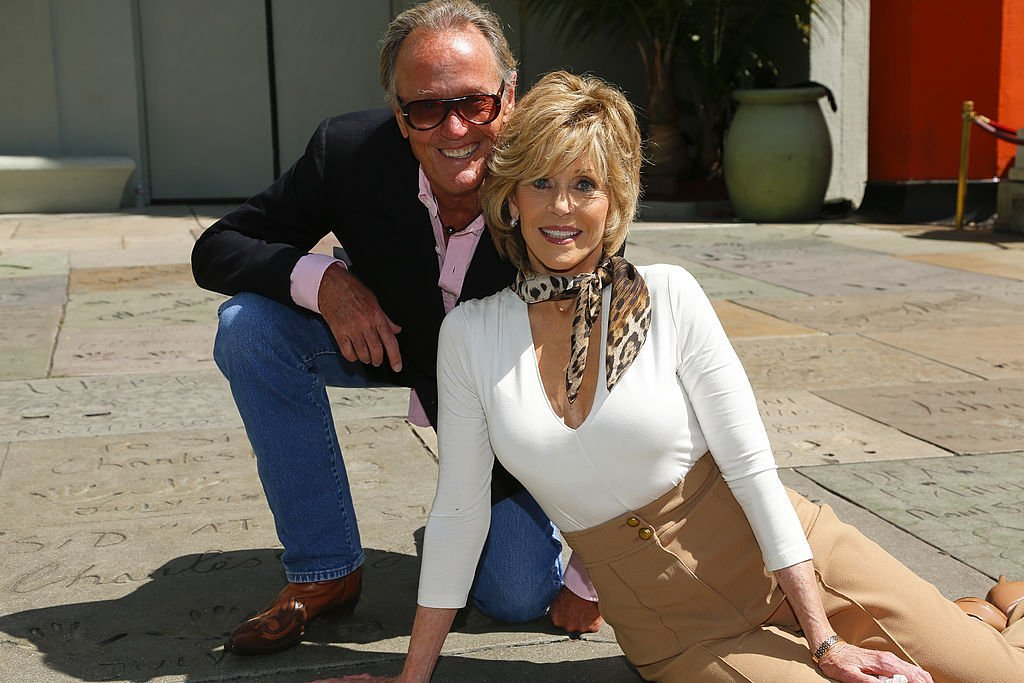 Actors Peter Fonda (L) and Jane Fonda attend Jane Fonda's hand and footprint ceremony at TCL Chinese Theatre | Photo: Getty Images