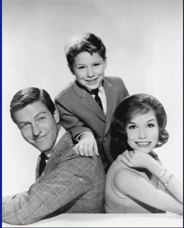American actors (left to right) Dick Van Dyke, Larry Mathews and Mary Tyler Moore, in a promotional portrait for 'The Dick Van Dyke Show', circa 1965. | Source: GettyImages