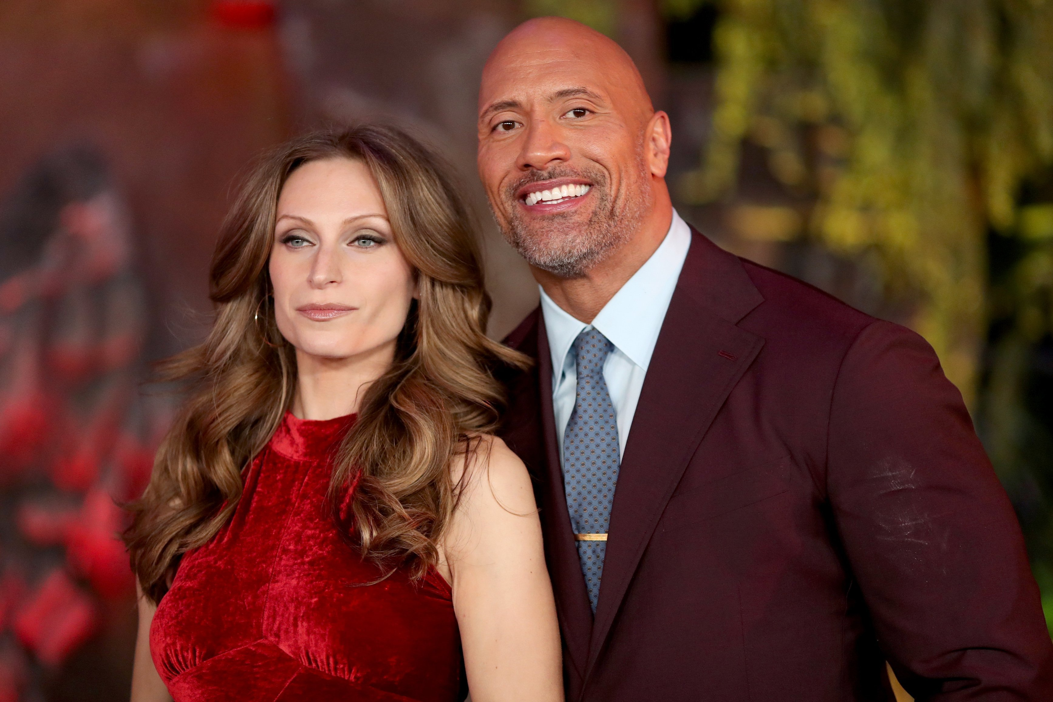 """Lauren Hashian and Dwayne Johnson attend the premiere of """"Jumanji: Welcome To The Jungle"""" on December 11, 2017 in Hollywood, California. 