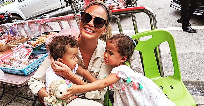 Chrissy Teigen's Daughter Luna Tries to Help Brother Miles up Their Playhouse Climbing Wall in Sweet Video
