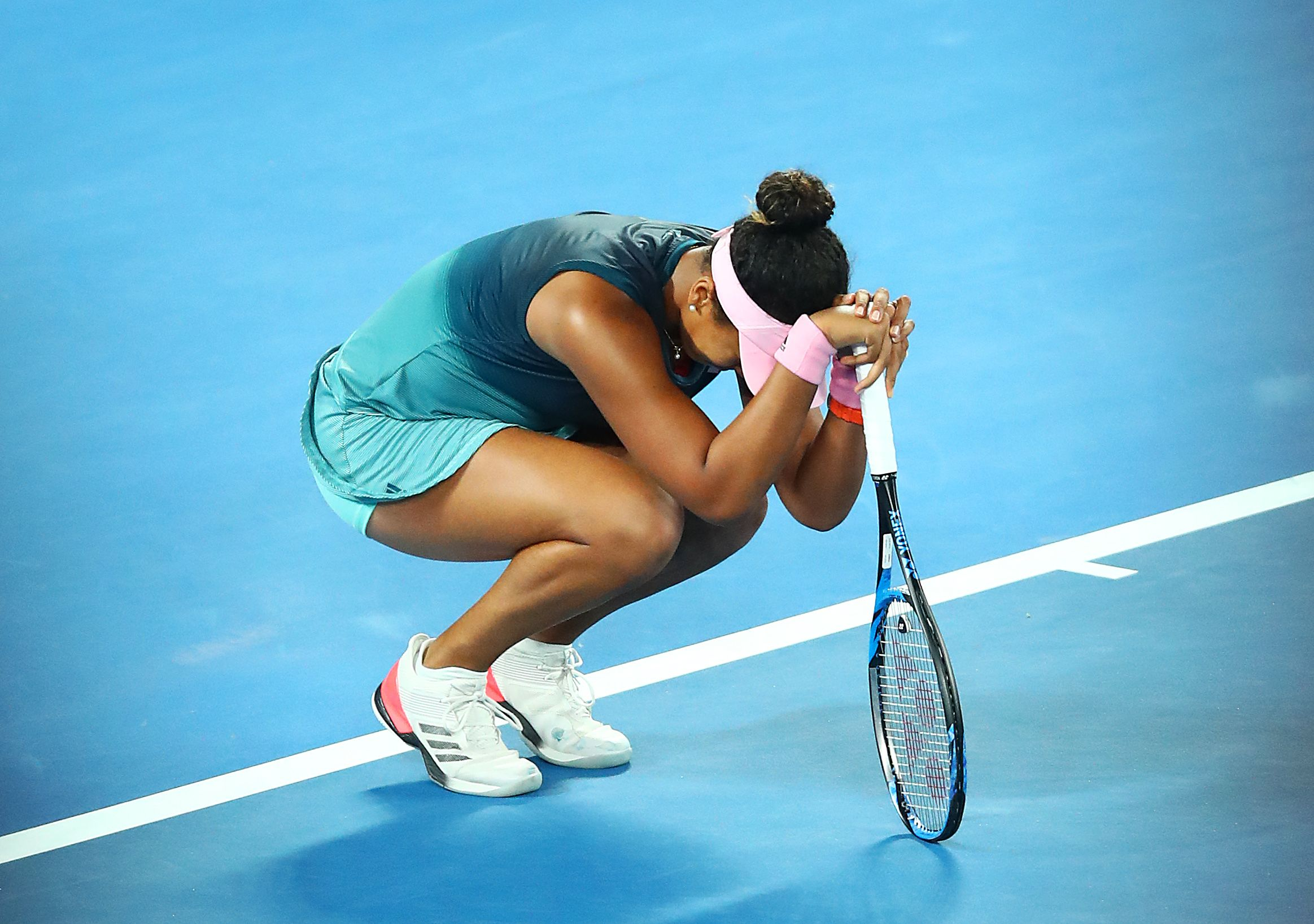Naomi Osaka of Japan takes part in a lap of honour with the Daphne Akhurst Memorial Cup on January 26, 2019 in Melbourne.    Photo: Getty Images