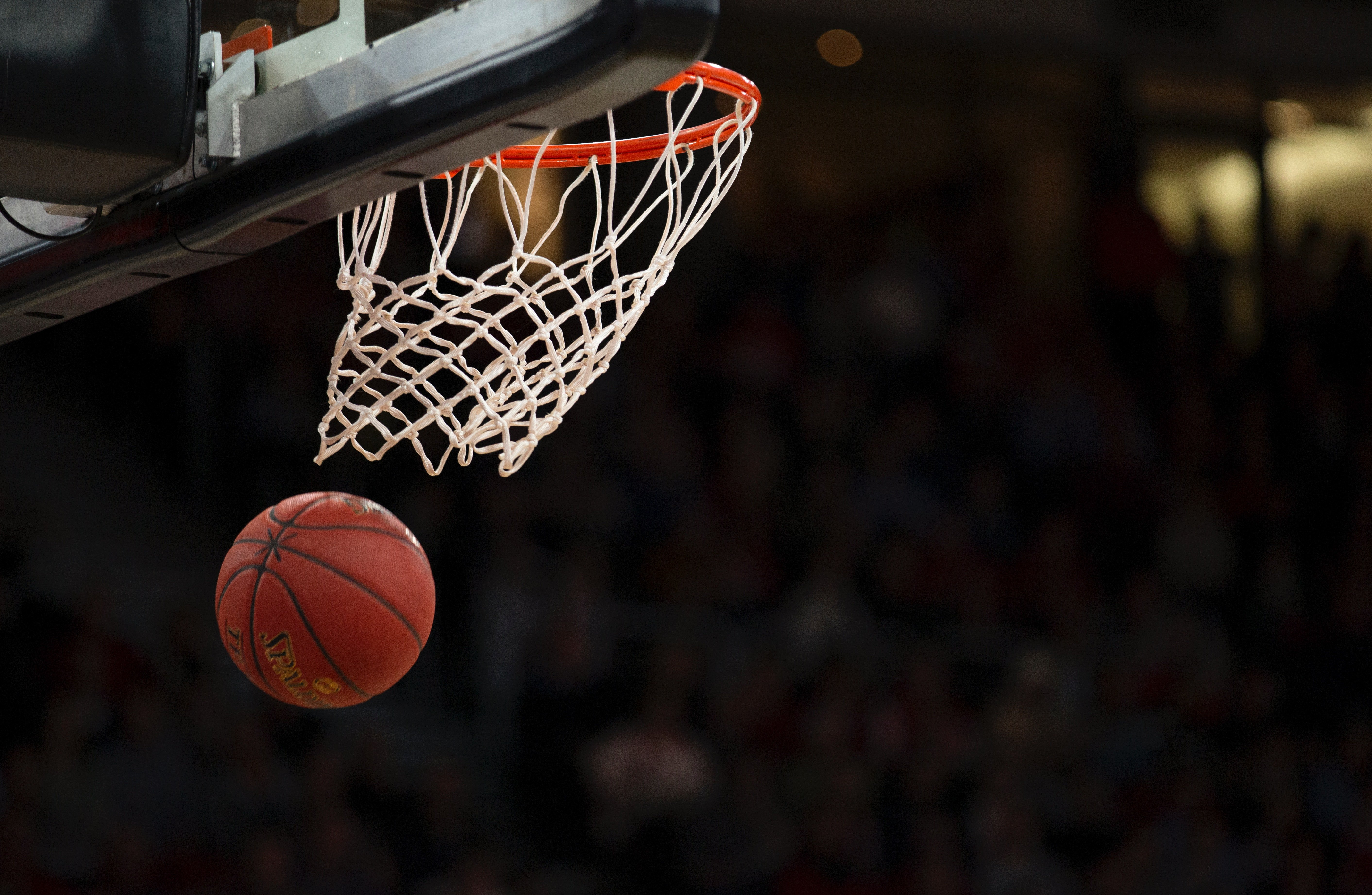 Picture of a Spalding basketball dropping after going through a white net.   Source: Pexels/Markus Spikse