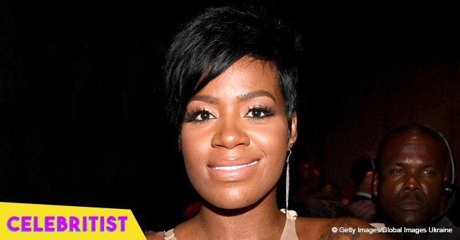 Fantasia's daughter looks all grown-up in jeans and black jacket in photo with young man