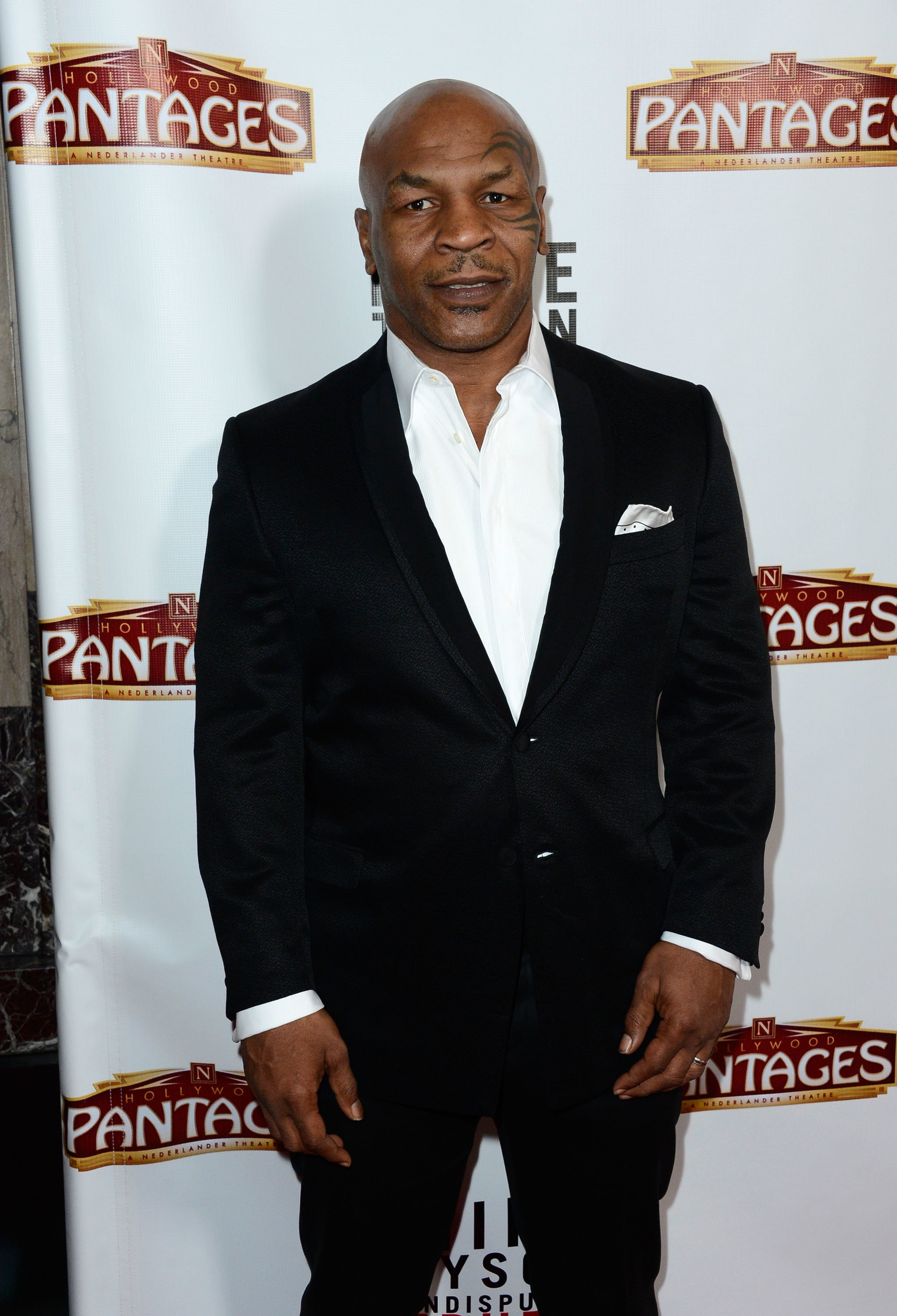 Mike Tyson arrives at the Pantages Theatre on March 8, 2013 in Hollywood, California | Photo: Getty Images