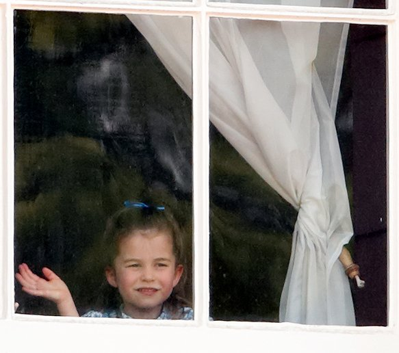 Princess Charlotte looks out the window of Buckingham Palace at Trooping the Color in June 2019 | Photo: Getty Images