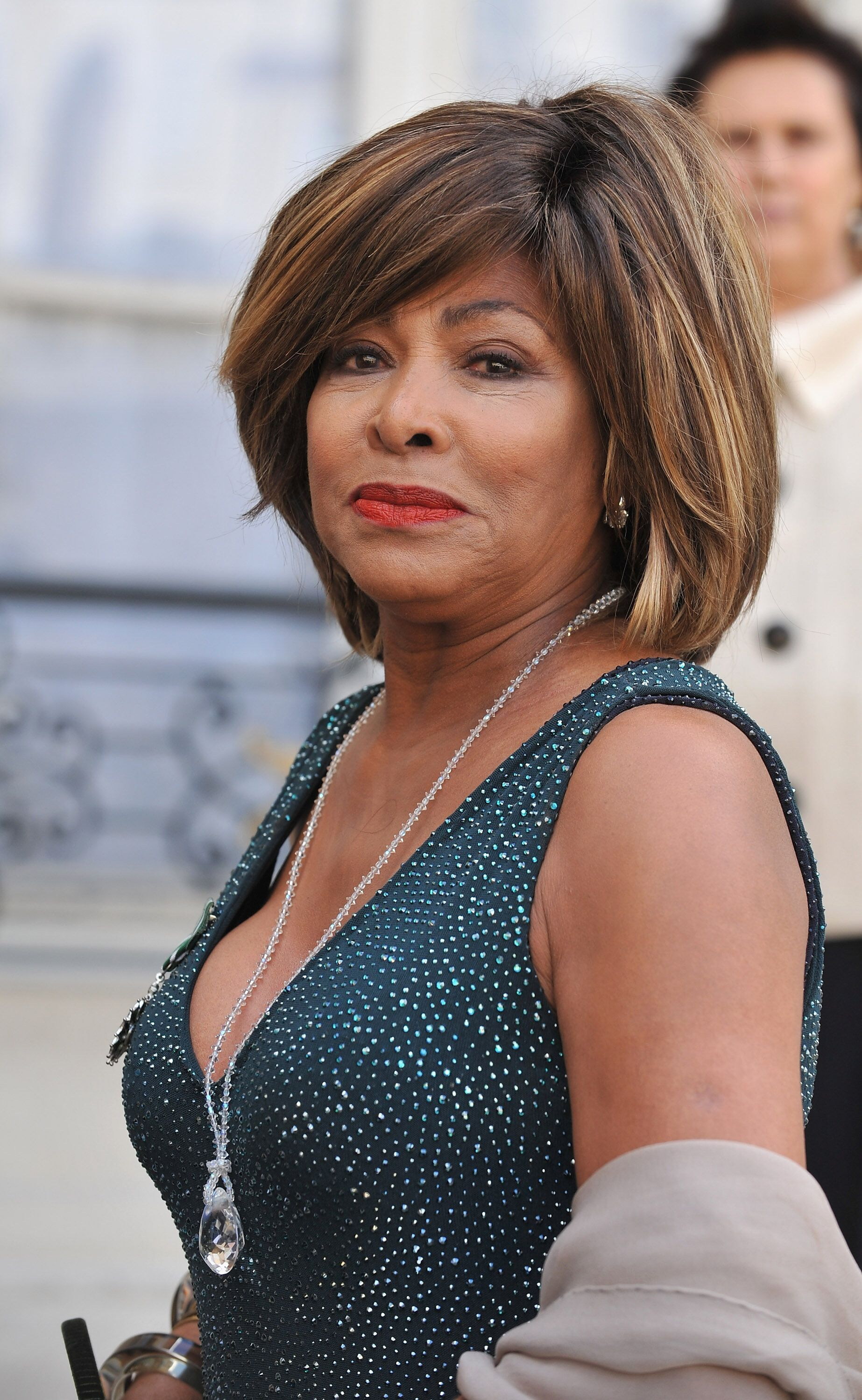 Tina Turner poses in the courtyard of the Elysee Palace before attending a ceremony at the president's official residence for honorees of France's most prestigious Legion D'Honneur award    Getty Images