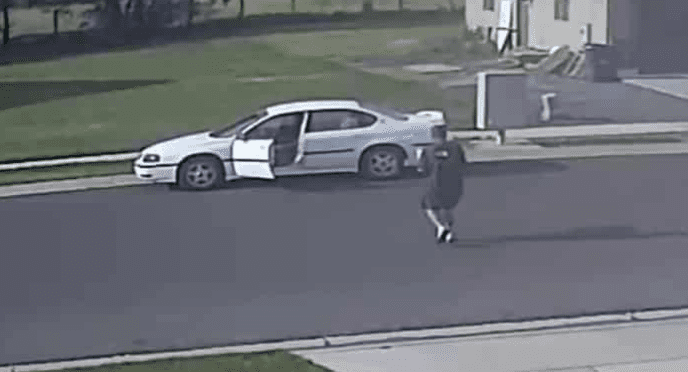 The porch pirate going back to his car, a white Sedan, carrying the stolen goods in the Hooper area, in Utah   Photo: Weber County Sheriff's Office