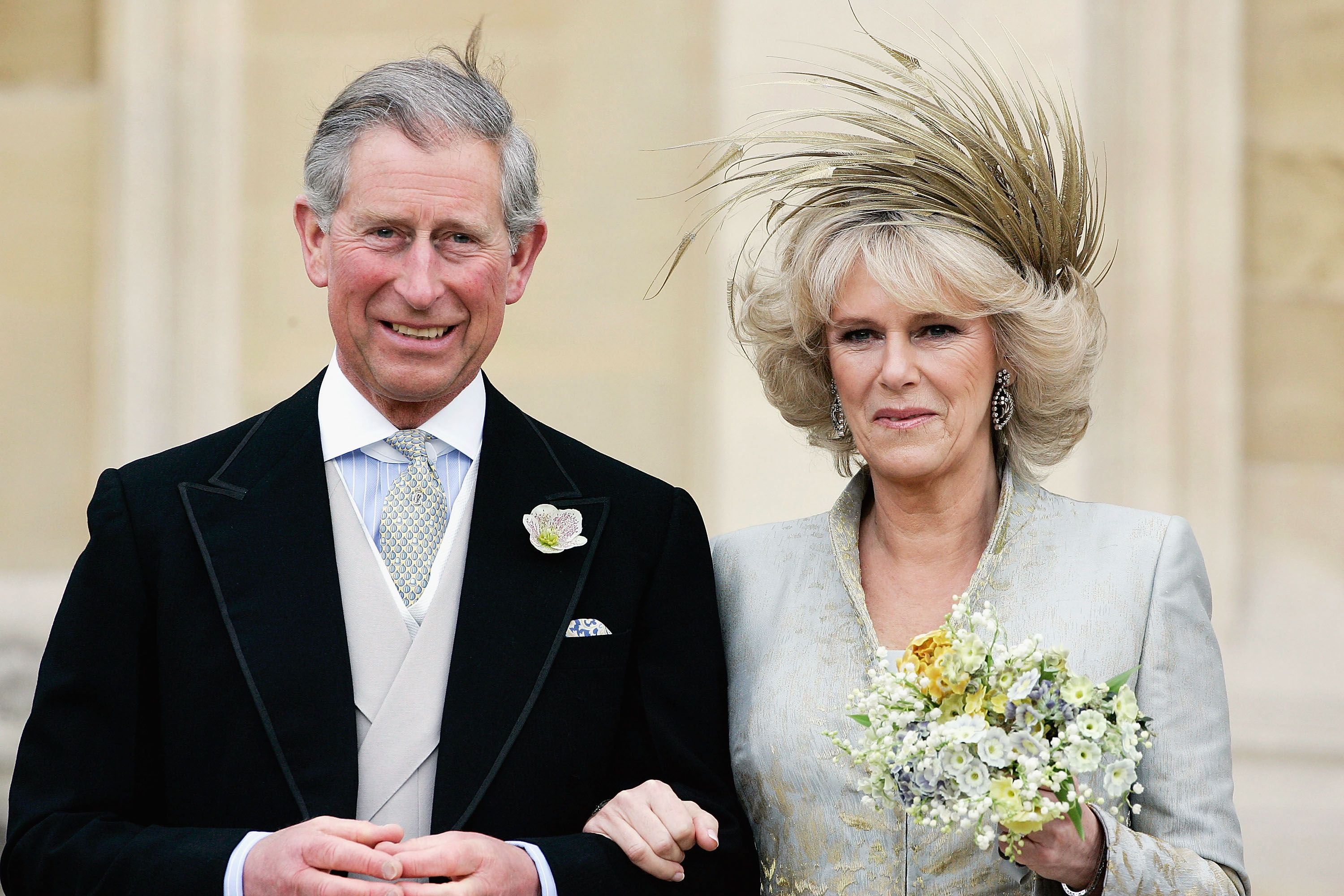 Prince Charles and Duchess Camilla leave the Service of Prayer and Dedication blessing at their marriage on April 9, 2005, in Berkshire, England | Photo: Tim Graham Photo Library/Getty Images