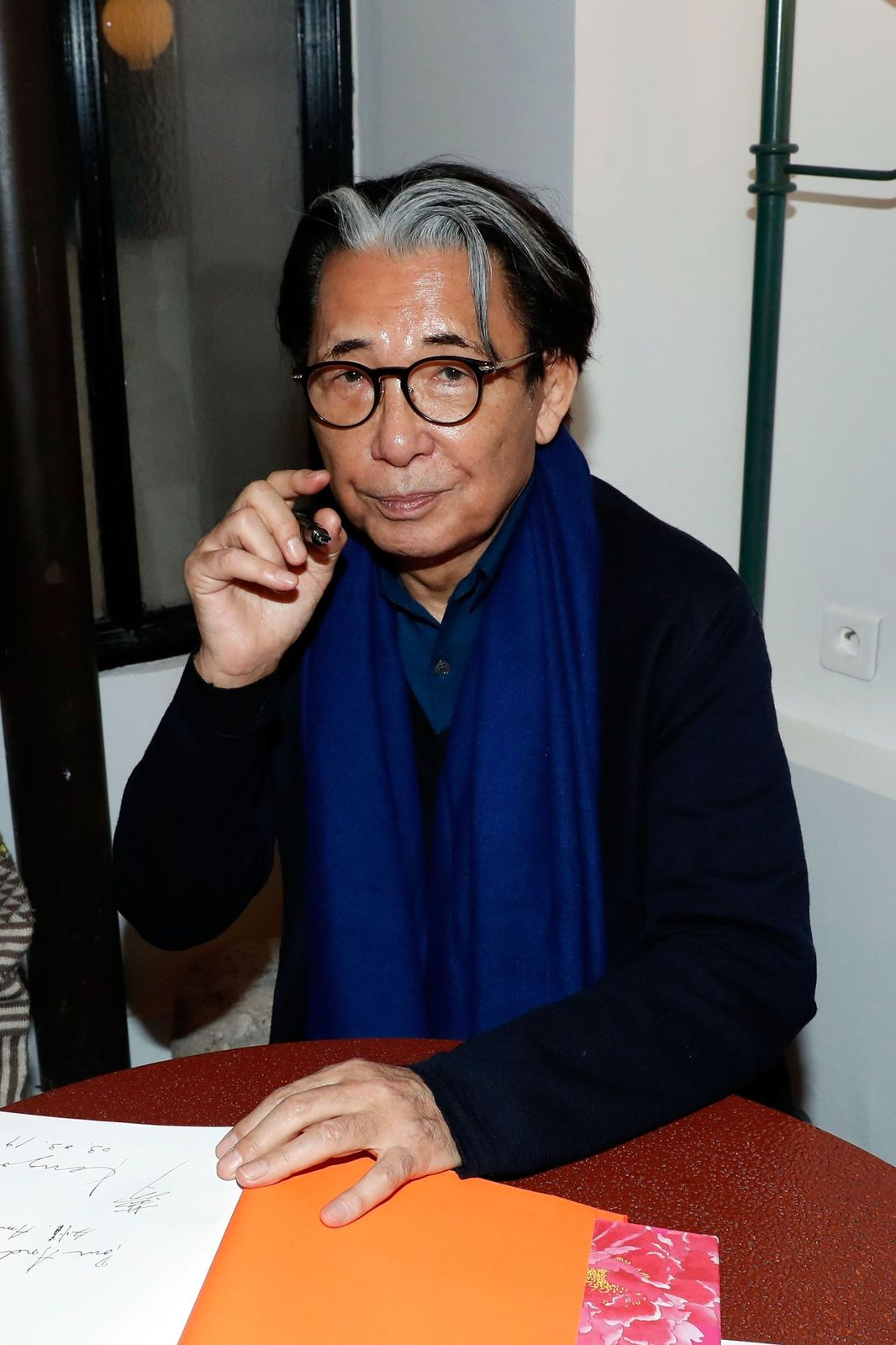 Kenzo Takada at a book signing as part of the Paris Fashion Week Womenswear Fall/Winter 2019/2020 on March 02, 2019, in Paris, France | Photo:Bertrand Rindoff Petroff/Getty Images