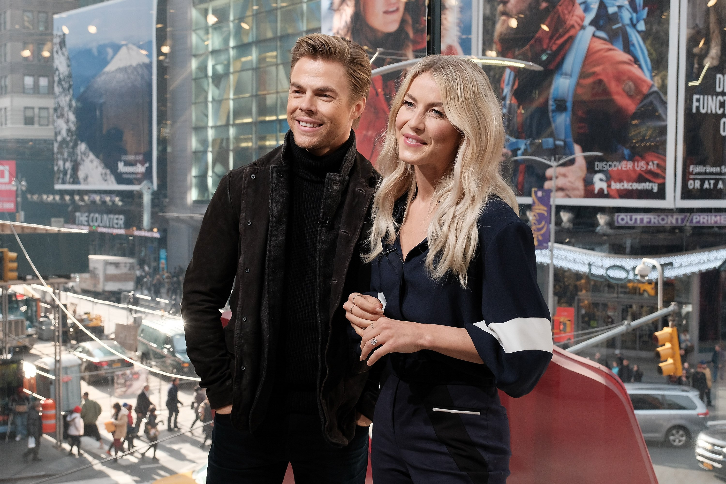 """Derek Hough and Julianne Hough visit """"Extra"""" in Times Square on December 13, 2016 