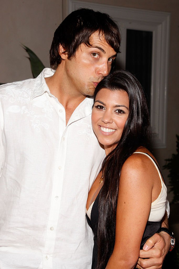 Kourtney Kardashian and Joe Francis arrive at the launch of the new Op Advertising Campaign Party, June 2008 | Source: Getty Images