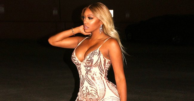 Porsha Williams Is Unrecognizable with Blonde Hair, Posing in Nude Dress with Deep Neckline