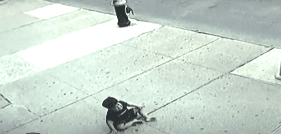 Surveillance video from a Bronx store shows Jose Garcia on the ground | Photo: YouTube/CBS New York