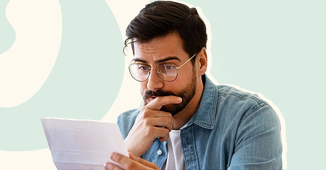 Photo of a man reading a note. | Photo: Shutterstock