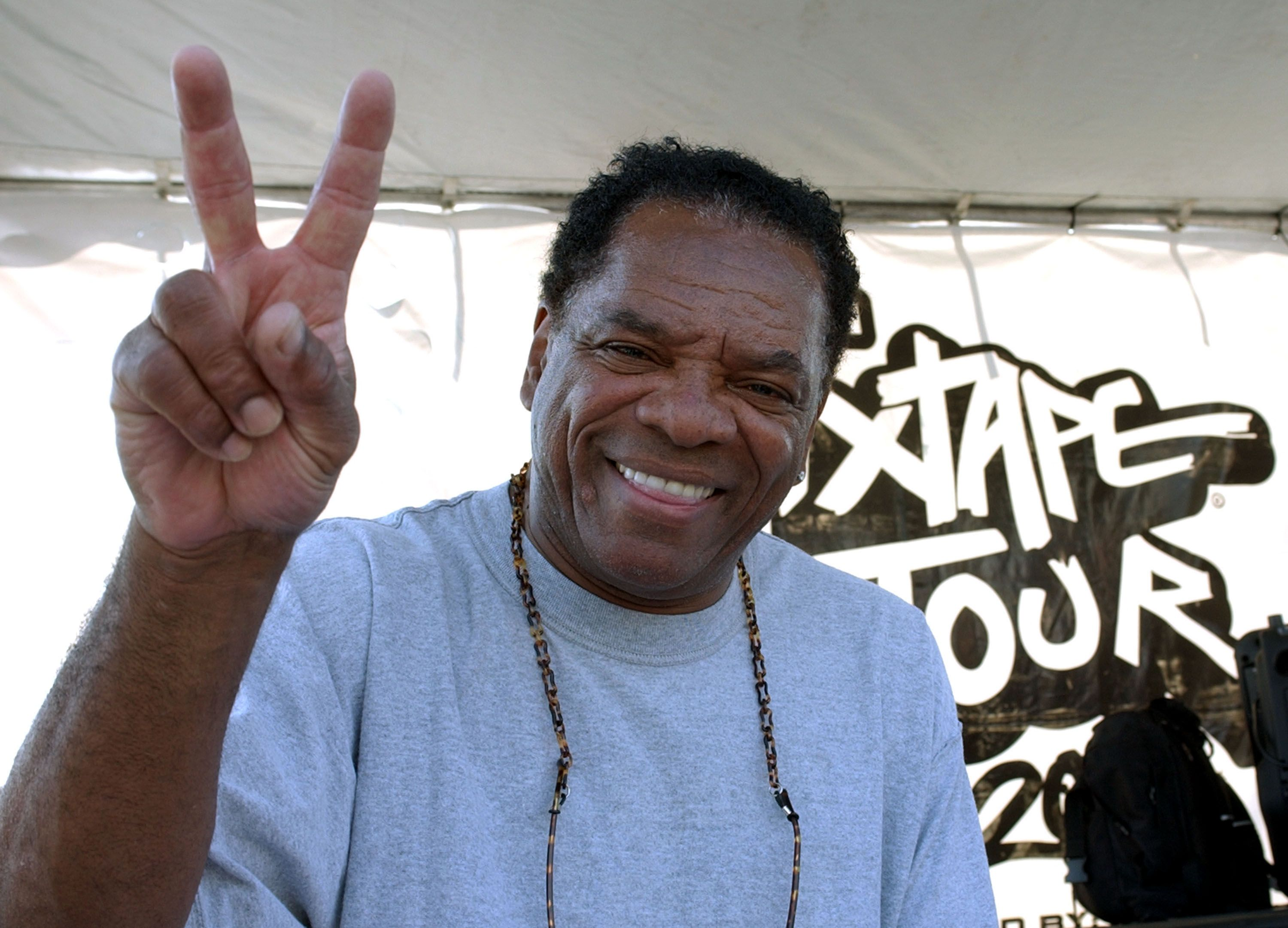 John Witherspoon looks on as Los Angeles Street Ballers compete for the chance to play against the 2004 Team AND1 on the blacktop of the The Great Western Fourm on June 9, 2004 | Photo: Getty Images