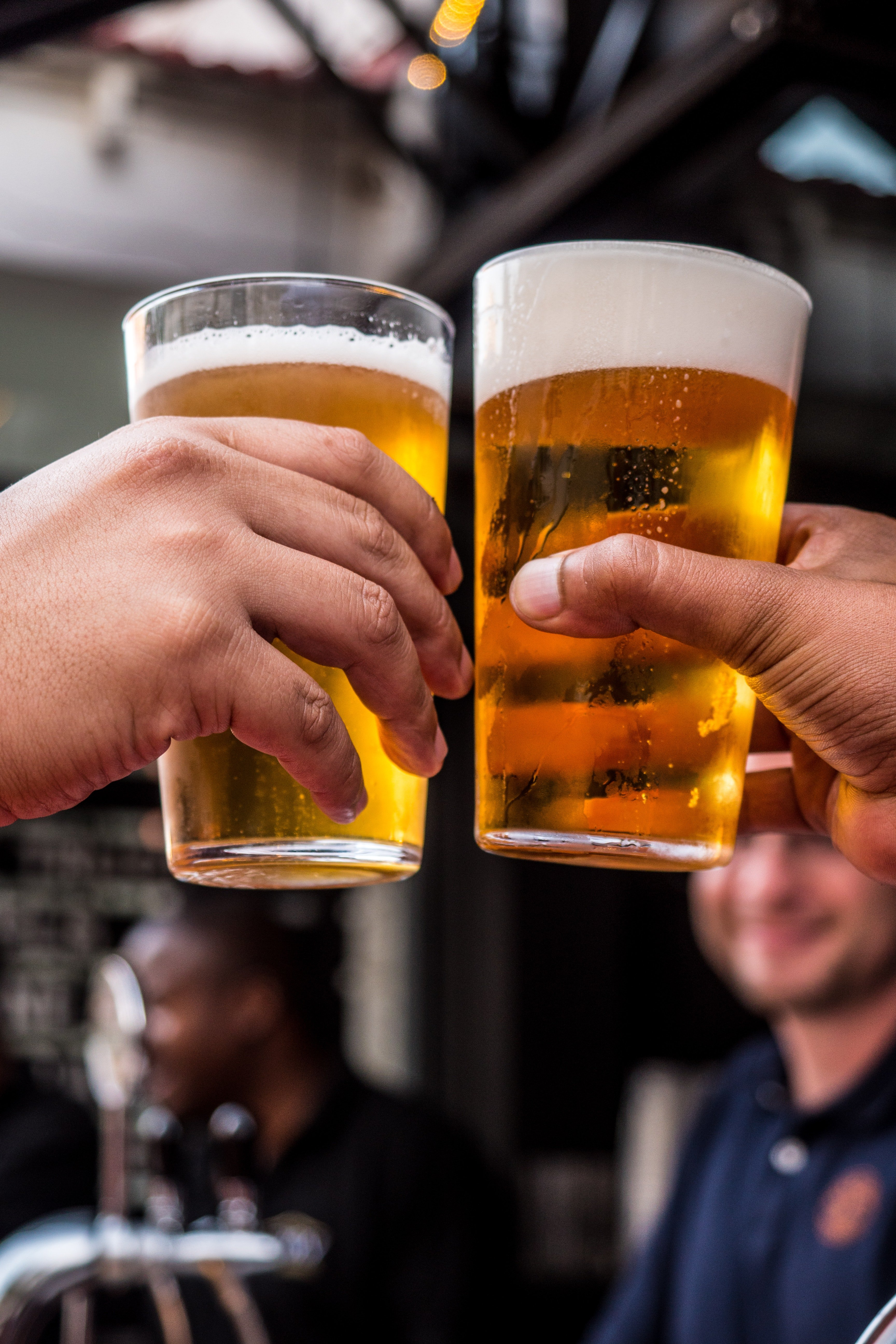 """""""Bottoms up, man,"""" said one friend to the other. They then began downing drinks. 