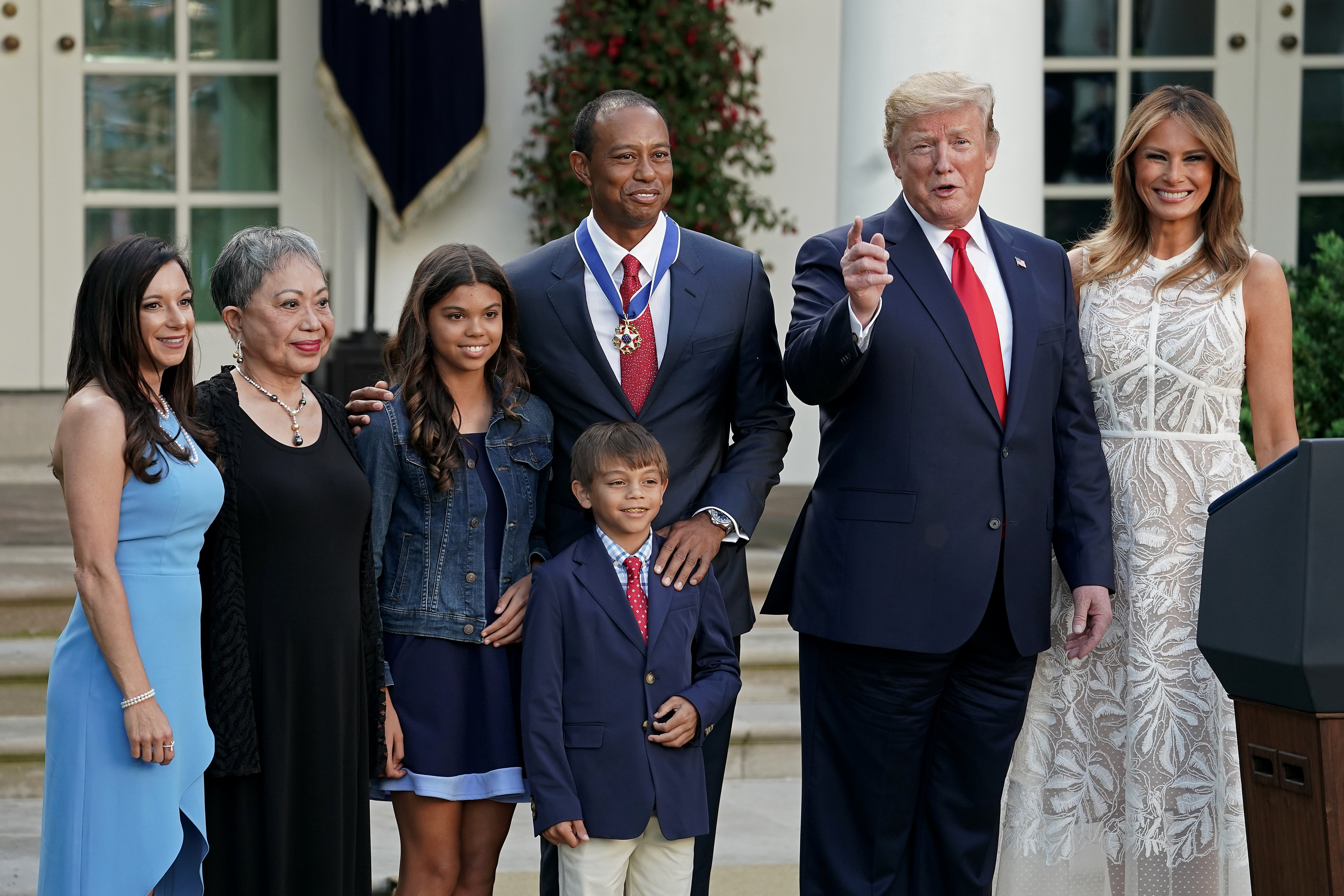 Donald Trump and Melania Trump pose with Tiger Woods and his family in the Rose Garden at the White House | Photo: Getty Images