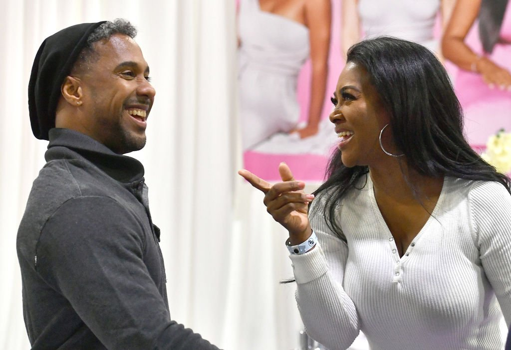 Marc Daly and Kenya Moore attend 2020 Bronner Brothers International Beauty Show at Georgia World Congress Center on February 08, 2020 in Atlanta, Georgia | Photo: Getty Images