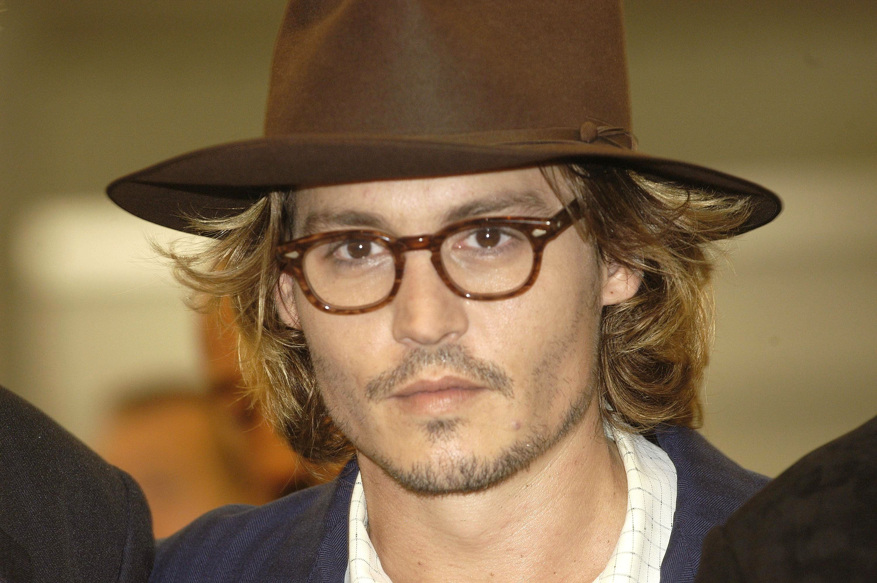 """Johnny Depp at the premiere of """"Once Upon a Time in Mexico"""" at the 60th Venice Film Festival on August 28, 2003, in Italy   Photo: Franco Origlia/Getty Images"""