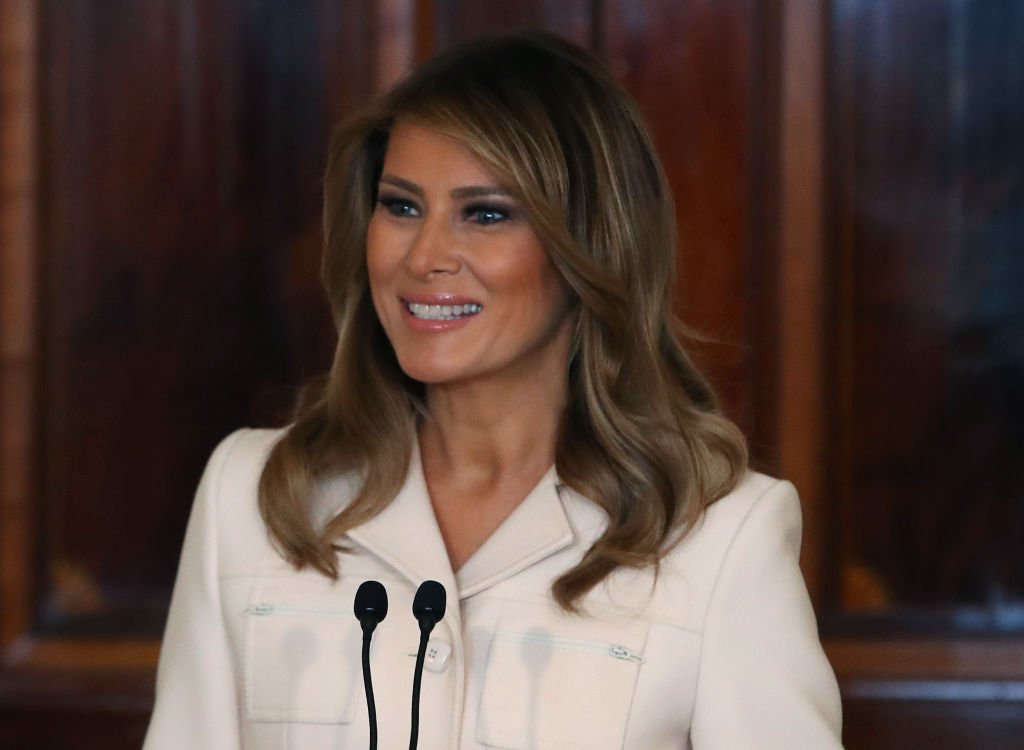 Melania Trump stand at a podium as she delivered at speech at the Governors Spouses Luncheon in the Blue Room of the White House on February 10, 2020, in Washington, DC | Source: Mark Wilson/Getty Images