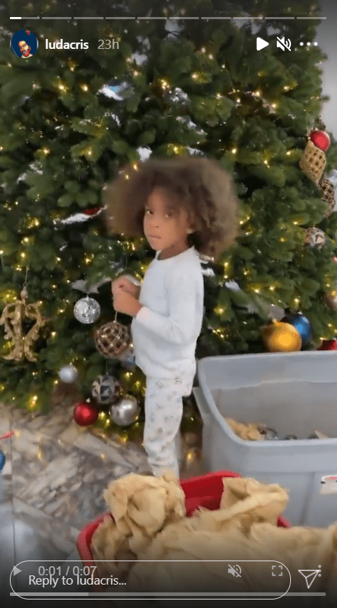 A screenshot from Ludacris' Instagram story featuring his daughter Cadence decorating their Christmas tree.   Source: Instagram.com/Ludacris