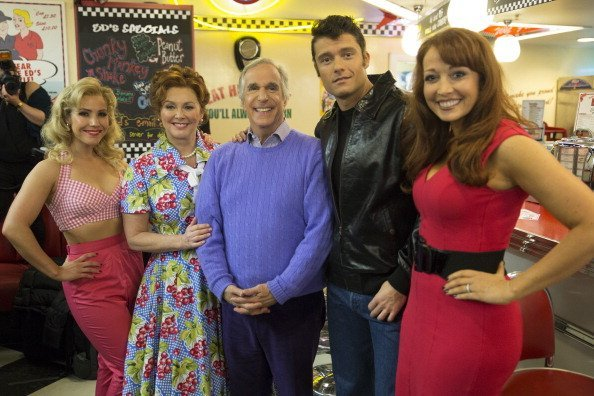 "Heidi Range, Cheryl Baker, Henry Winkler, Ben Freeman and Amy Anzel attend a photocall for new musical ""Happy Days"" at Ed's Easy Diner on January 8, 2014 