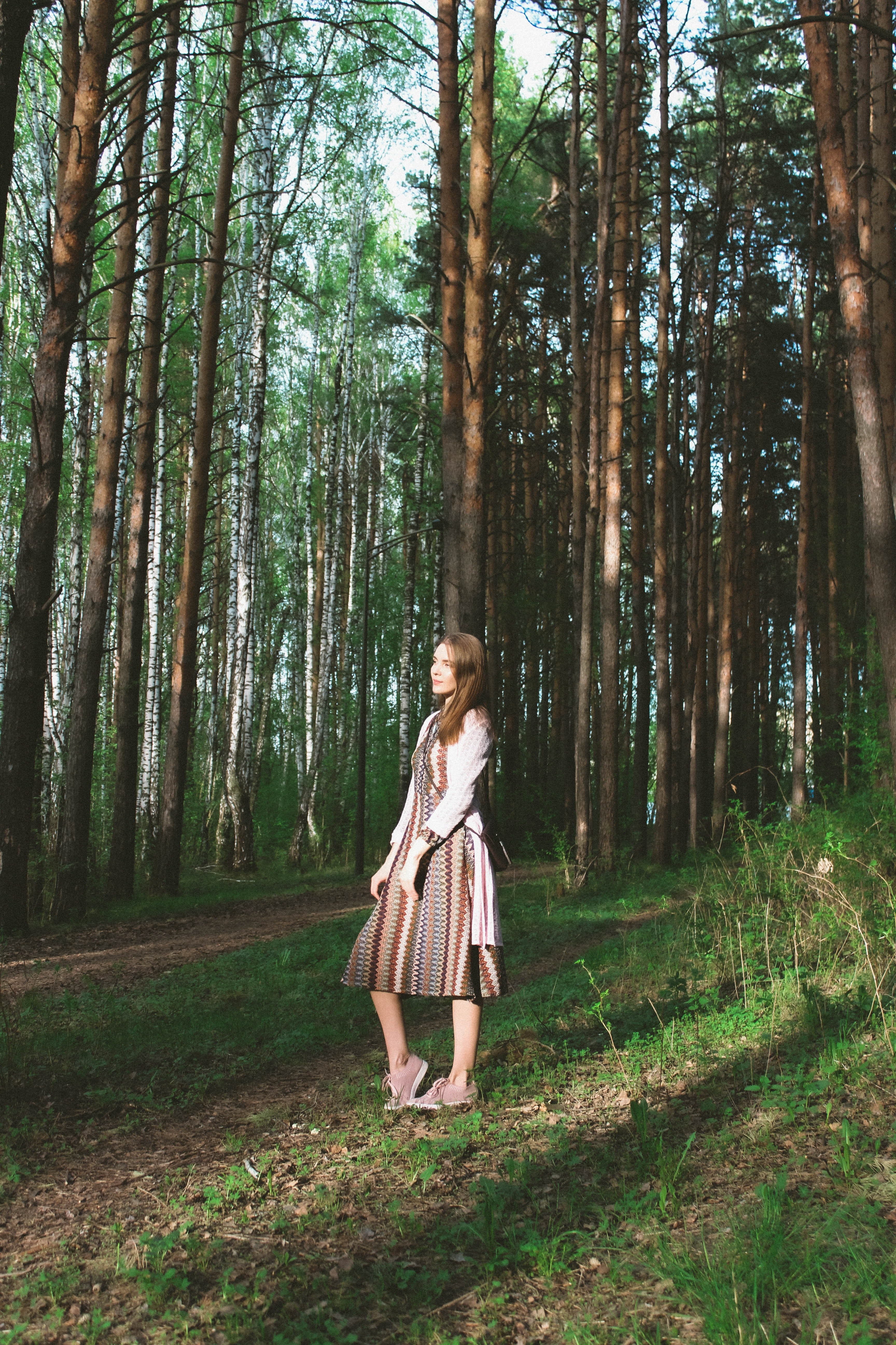 A woman in a dress standing in the forest. | Pexels/ Angelina Lobanova