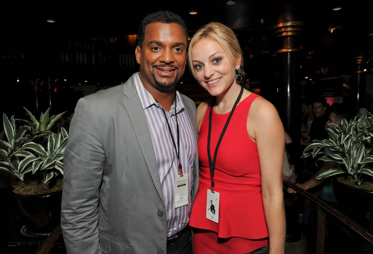 """Alfonso Ribeiro and Angela Unkrich attends the debut of Mark Ballas' EP, """"Kicking Clouds"""" at Crustacean on September 16, 2014 in Beverly Hills, California. 