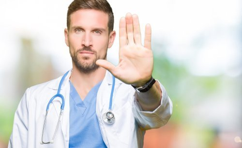 Warning from a man in a medical uniform. | Source: Shutterstock.