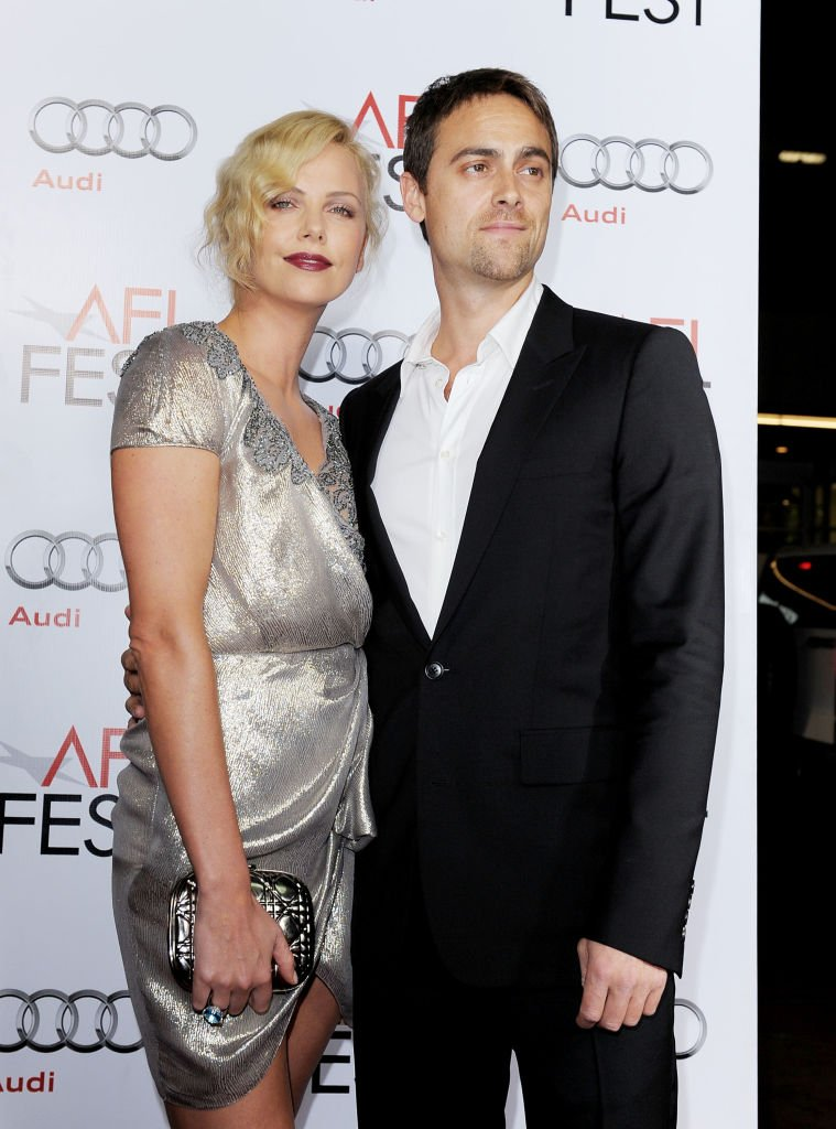 """Charlize Theron and boyfriend actor Stuart Townsend arrive at the AFI FEST 2009 screening of """"The Road""""  