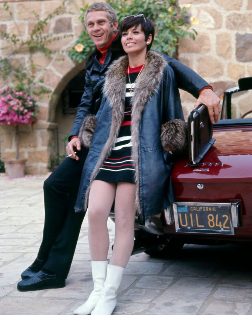 American actor Steve McQueen (1930 - 1980) with his wife, Filipino-american actress Neile Adams, sitting on a Ferrari 275 Cabriolet, Beverly Hills, 1970.   Source: Getty Images